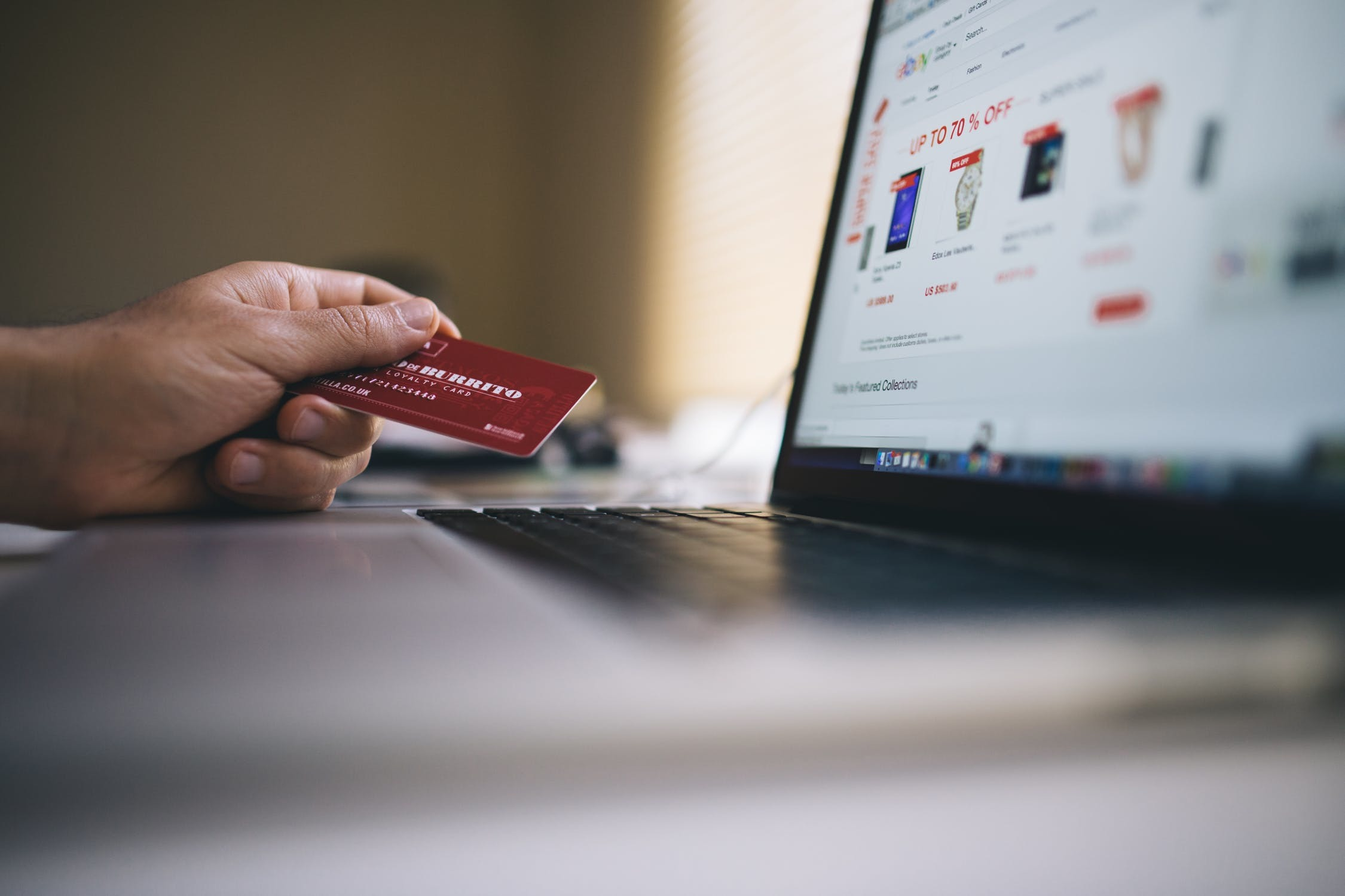 Person making a credit card payment online.